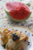 Watermelon and leftovers after the lunch Stock Photos