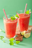 Watermelon lime smoothie in glasses Royalty Free Stock Photo