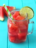 Watermelon lime water in mason jar on blue wood Royalty Free Stock Photo