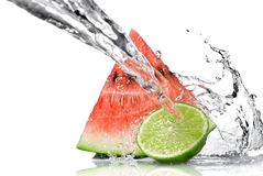 Watermelon, lime and water splash Stock Photography