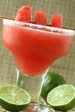 Watermelon Margarita. Fresh watermelon margarita with limes and watermelon wedges garnish Royalty Free Stock Image