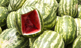 Watermelon at market. A pile of watermelon with  sample  at market display Royalty Free Stock Photo