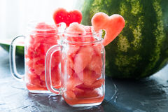 Watermelon in Mason jars decorated with watermelon slices curved Stock Images
