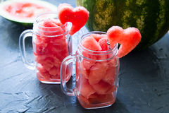 Watermelon in Mason jars decorated with watermelon slices curved Stock Image