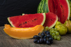 Watermelon, melon, grapes, peach, Pear, pumpkin on old wooden ta Stock Photo