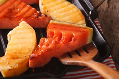 Watermelon and melon in a pan grill macro. horizontal Stock Photos