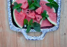 Watermelon with mint stock images