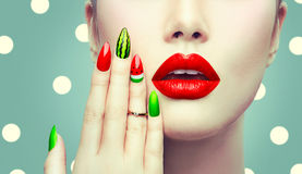 Watermelon nail art and makeup closeup. Over polka dots background stock images