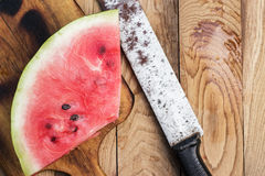 Watermelon and old knife on the table Royalty Free Stock Photos
