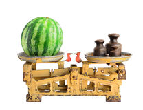 Watermelon on old scales Royalty Free Stock Image