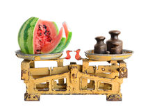 Watermelon on old scales Royalty Free Stock Photos