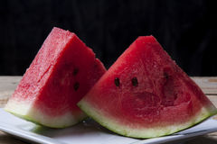 Watermelon on a old wooden table Royalty Free Stock Photo
