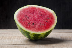 Watermelon on a old wooden table Royalty Free Stock Photography