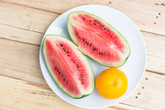 Watermelon and orange in white dish Royalty Free Stock Images