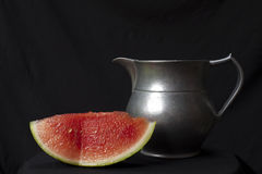 Watermelon and pewter jug Royalty Free Stock Image
