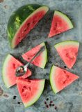 Watermelon pieces. Watermelon sliced in triangle pieces on an old metal board Royalty Free Stock Image
