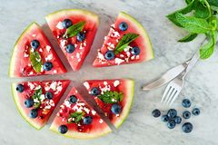 Watermelon pizza with blueberries, feta and mint over marble Stock Image