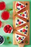 Watermelon pizza slices with yogurt and berries, summer dessert stock photo