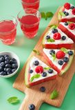 Watermelon pizza slices with yogurt and berries, summer dessert stock image