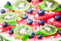 Watermelon pizza on white Stock Photos