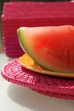 Watermelon on plate. Slices of watermelon on picnic table royalty free stock images