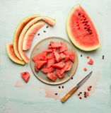 Watermelon on plate with knife on blue rustic background Stock Photo