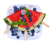 Watermelon popsicle and blueberries on plate isolated Royalty Free Stock Photography