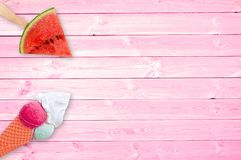 Watermelon popsicle and ice cream cone on pink planks with copy space, summer concept. Watermelon popsicle and ice cream cone on pink planks background with copy Stock Photography