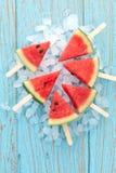 Watermelon popsicle yummy fresh summer fruit sweet dessert wood teak. Watermelon popsicle yummy fresh summer fruit sweet dessert on vintage old wood teak blue Royalty Free Stock Image