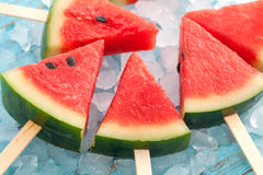 Watermelon popsicle yummy fresh summer fruit sweet dessert wood teak. Watermelon popsicle yummy fresh summer fruit sweet dessert on vintage old wood teak blue Stock Photography