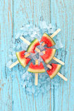 Watermelon popsicle yummy fresh summer fruit sweet dessert wood teak Stock Image