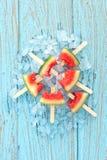 Watermelon popsicle yummy fresh summer fruit sweet dessert wood teak. Watermelon popsicle yummy fresh summer fruit sweet dessert on vintage old wood teak blue Stock Image