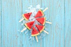 Watermelon popsicle yummy fresh summer fruit sweet dessert wood teak. Watermelon popsicle yummy fresh summer fruit sweet dessert on vintage old wood teak blue Stock Photos