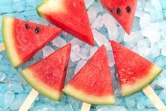 Watermelon popsicle yummy fresh summer fruit sweet dessert wood teak. Watermelon popsicle yummy fresh summer fruit sweet dessert on vintage old wood teak blue Stock Images