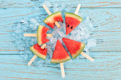 Watermelon popsicle yummy fresh summer fruit sweet dessert wood teak Royalty Free Stock Image