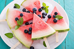 Watermelon popsicles with blueberry stock images