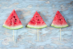 Watermelon popsicles over wooden background. Top view. Watermelon popsicles over blue wooden background. Top view Stock Photo