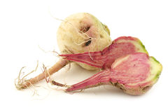 Watermelon radish and a cut one Royalty Free Stock Photography