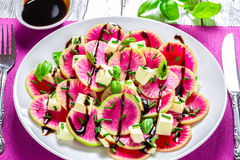 Watermelon radish salad with mozzarella, onion chives and basil, Royalty Free Stock Photo