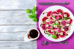 Watermelon radish salad, mozzarella, onion chives, basil. Top view Royalty Free Stock Photos