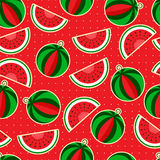 Watermelon on a red background. Ripe watermelon and slices on a red background Stock Image