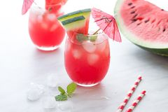 Watermelon cocktail with lemon and mint. Refreshing lemonade close up. Watermelon red cocktail with lemon and mint. Refreshing lemonade close up Stock Photo