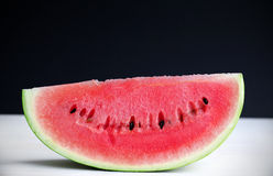 Watermelon, ripe and juicy slice Stock Images