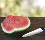 Watermelon. On rustic wood, knife Stock Image