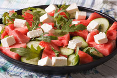 Watermelon salad with feta cheese, arugula and cucumber closeup Stock Photos