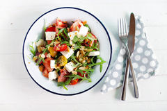 Watermelon salad with feta cheese and arugula, toasted almonds Stock Photo
