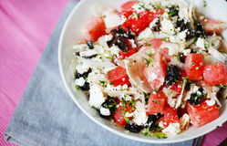 Watermelon salad with feta cheese, olives, onion and thyme Stock Image
