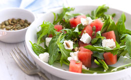 Watermelon Salad. With feta cheese, toasted pumpkin seeds, arugula, spinach and mint Stock Images