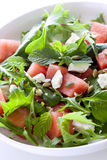 Watermelon Salad. With feta cheese, toasted pumpkin seeds, arugula, spinach and mint Stock Image