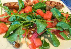 Watermelon salad with grilled porl Royalty Free Stock Photos